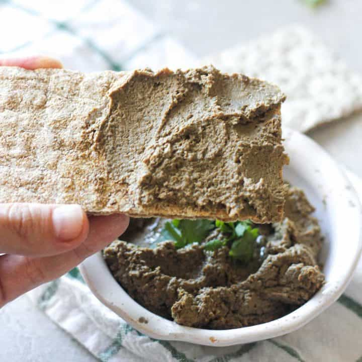 square image of pate on the piece of whole wheat cracker