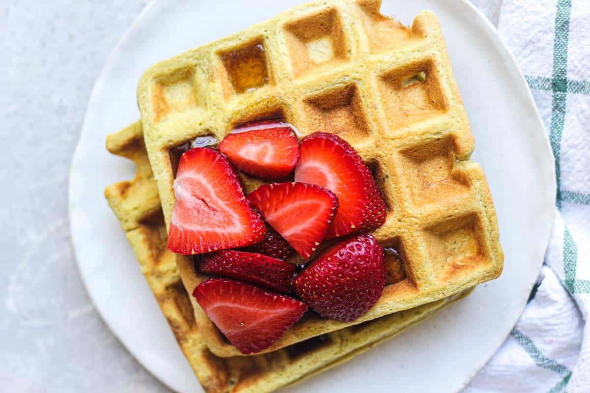 top view of two waffles with berries on top