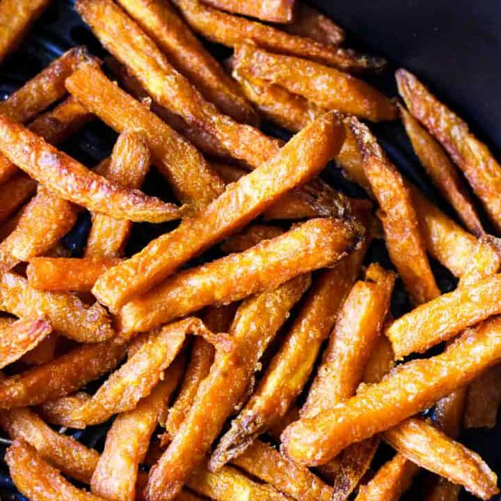cooked crispy fries in black air fryer basket