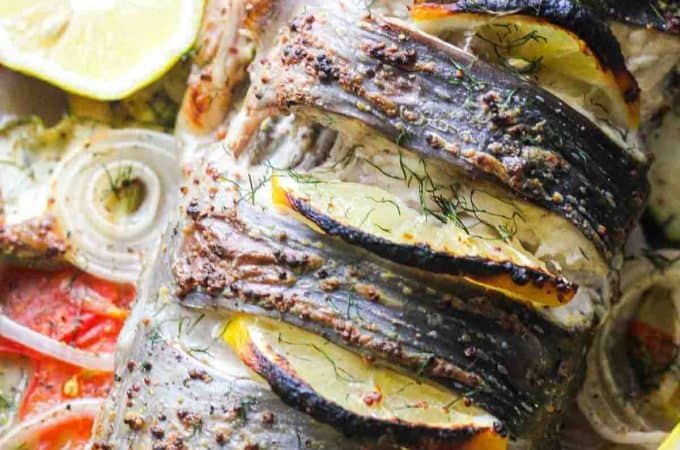 baked whole catfish with lemon slices