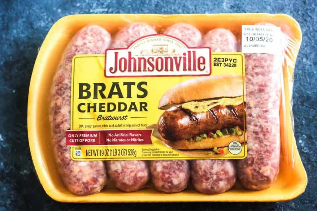 raw brats cheddar bratwurst in the package before cooking in air fryer