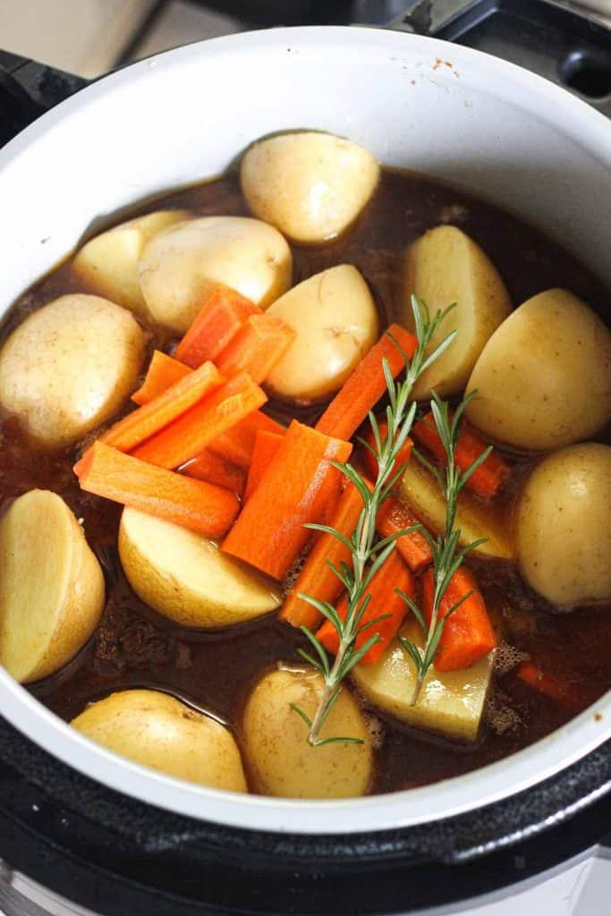 raw potatoes and carrots in ninja foodi pressure cooker before cooking