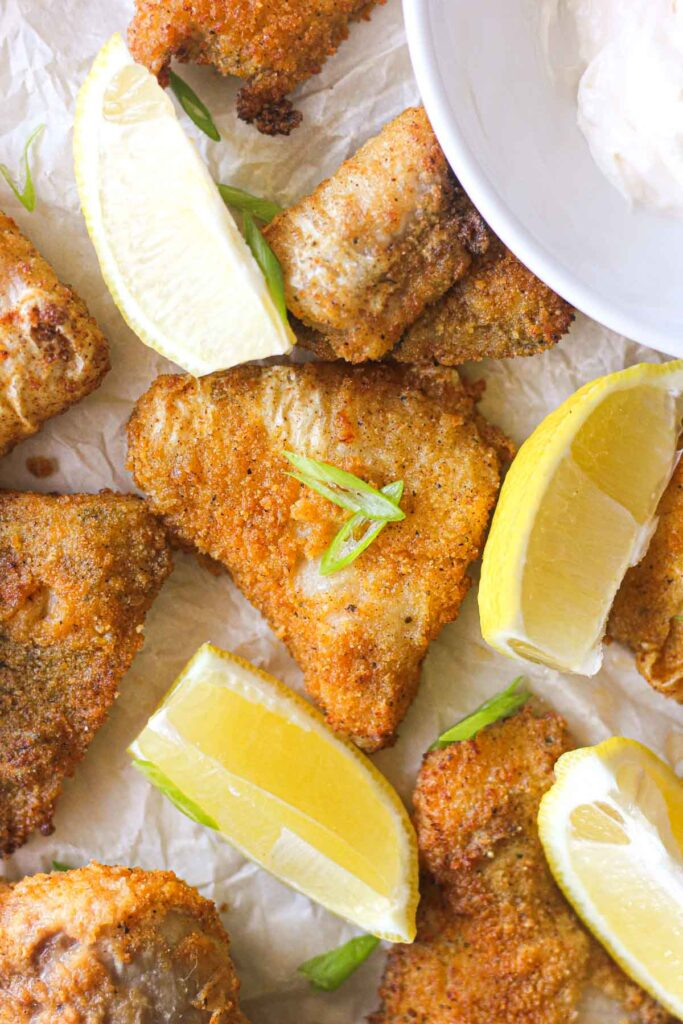 golden colored breaded catfish nuggets with lemon