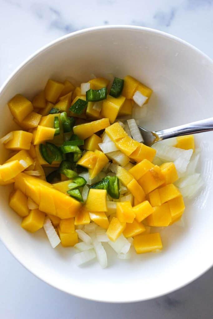 chopped mango citrus salsa in the bowl