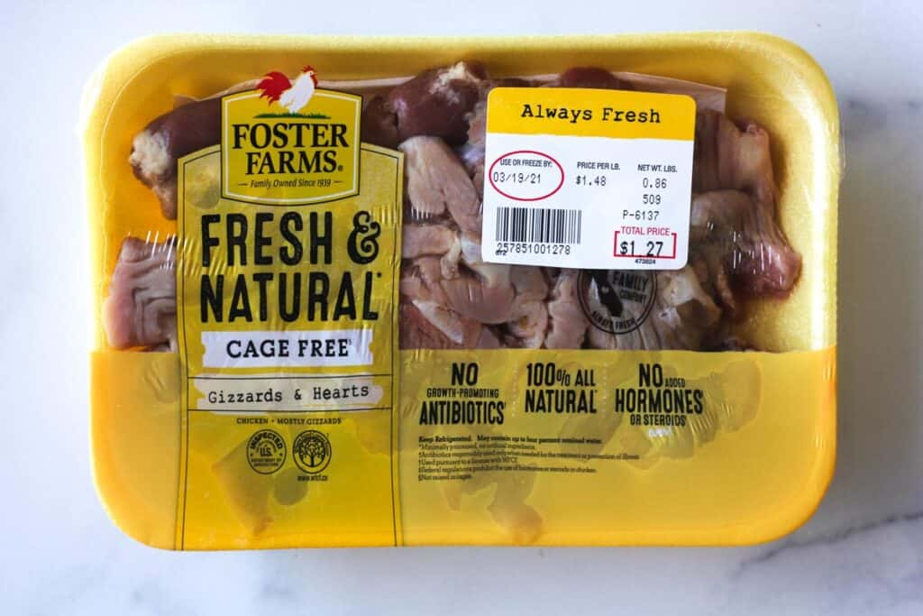 a package of chicken hearts and gizzards on a table