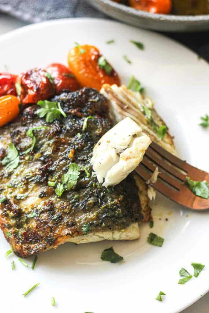 cooked barramundi fillet piece on a fork