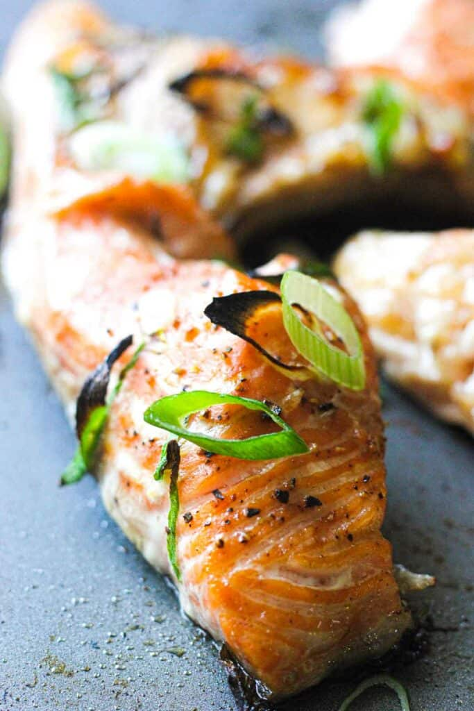 roasted salmon collars with sliced green onions
