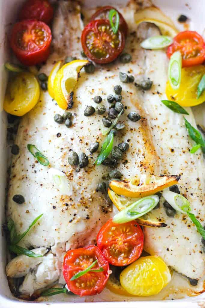 baked sea bream with capers and cherry tomatoes on top