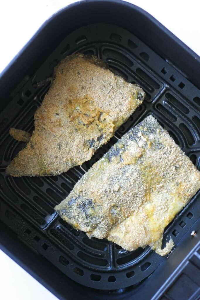 raw walleye fish in the air fryer basket