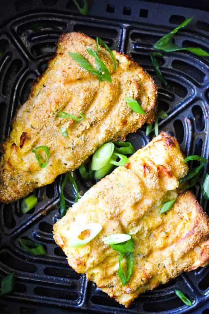 air fryer walleye fish with chopped green onions on top