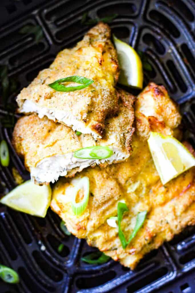 cooked walleye in the air fryer with chopped green onions on top