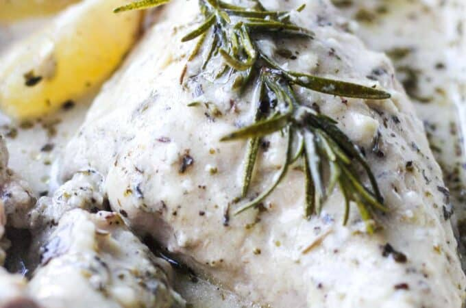 juicy rabbit coked in the oven with herbs and lemon