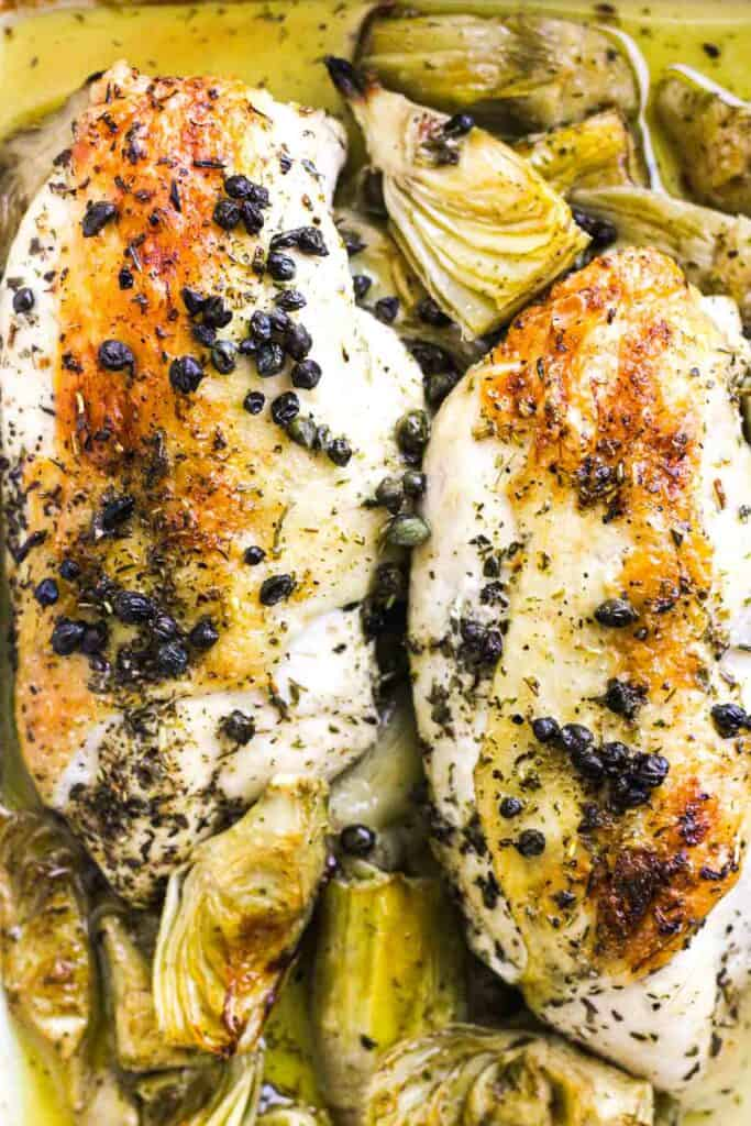 golden baked brown chicken with vegetables and capers