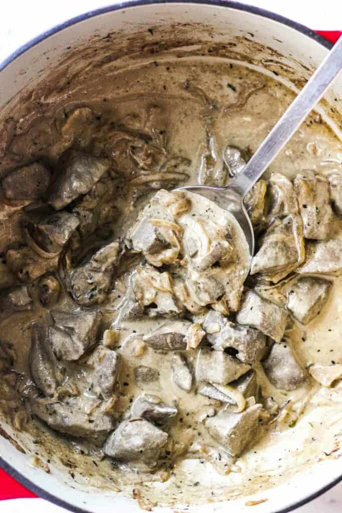 creamy sour cream sauce with pig liver in a pot