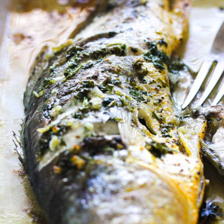 bake herbed yellow croaker with a fork stuck in it