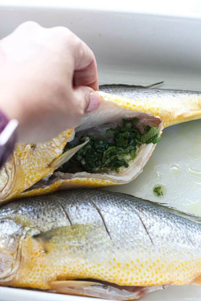 stuffing fish with cilantro mixture