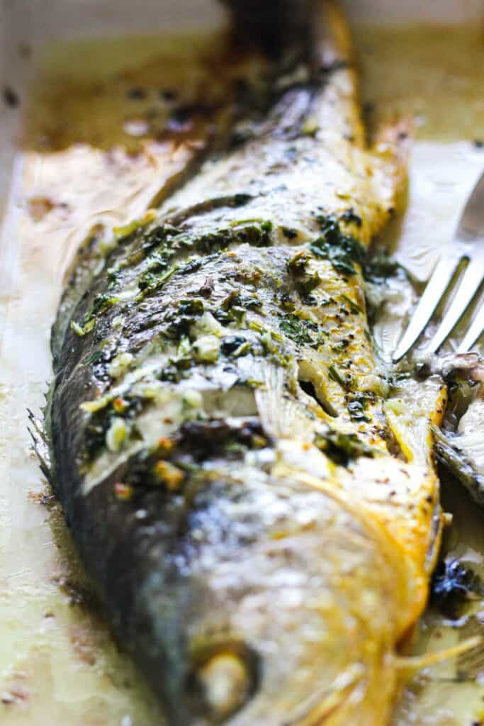 whole broiled yellow croaker with head on just out of the oven