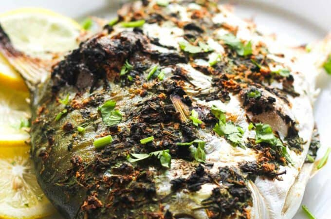 cooked pompano fish with spices and lemon