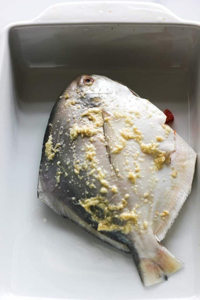 whole fish covered in ginger paste
