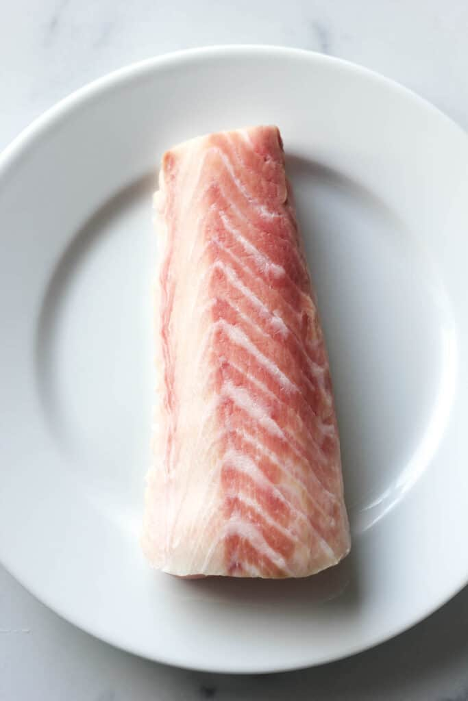 raw cobia fish fillet on the plate