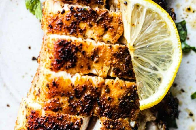 close picture of pan seared cobia with spices and lemon