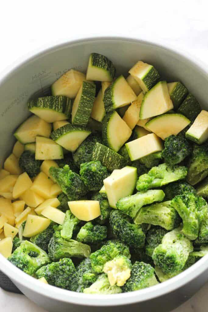 broccoli, zucchini and potatoes in the pressure cooker inner pot