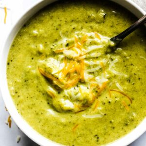 cooked green soup in a a white bowl