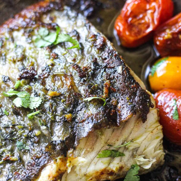 white fish fillet cooked with tomatoes and pesto