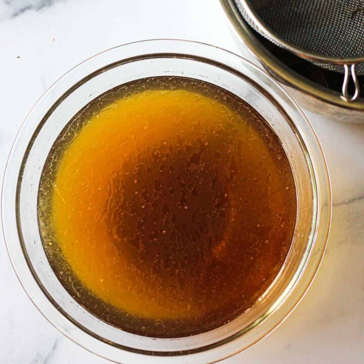 brown strained hen bone broth in a bowl