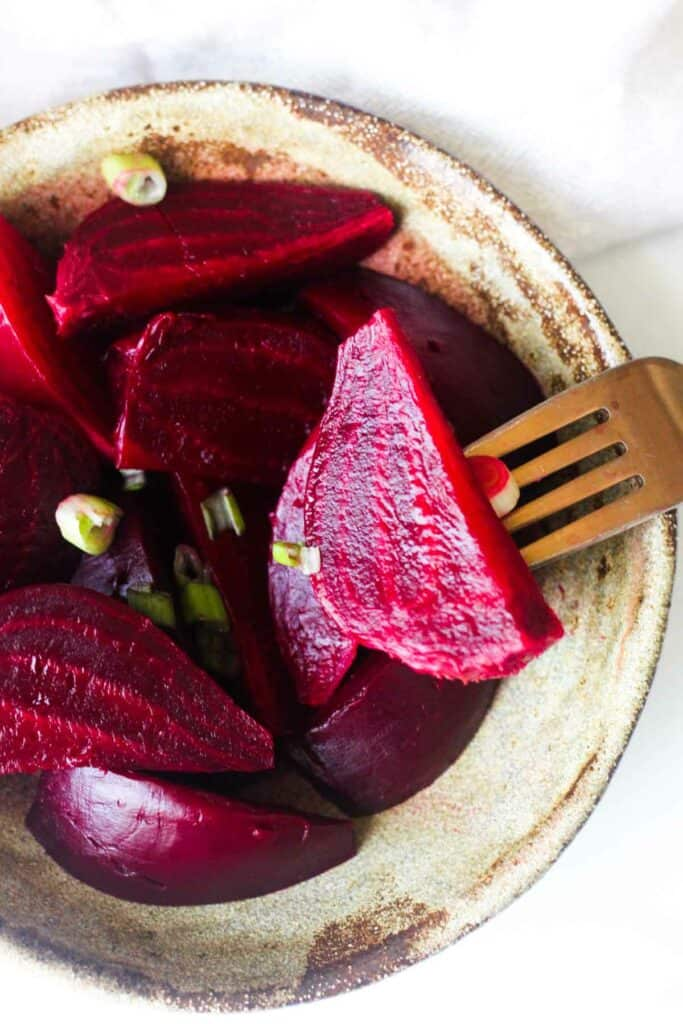 purple root vegetables in the brown plate