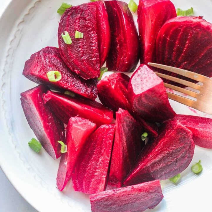 ninja foodi beets cut and served on a white plate