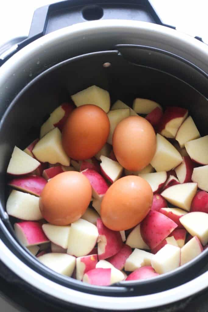 addind eggs and potatoes in to a pressure cooker