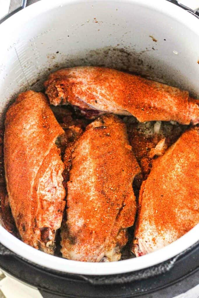 turkey wings covered in red spices like paprika