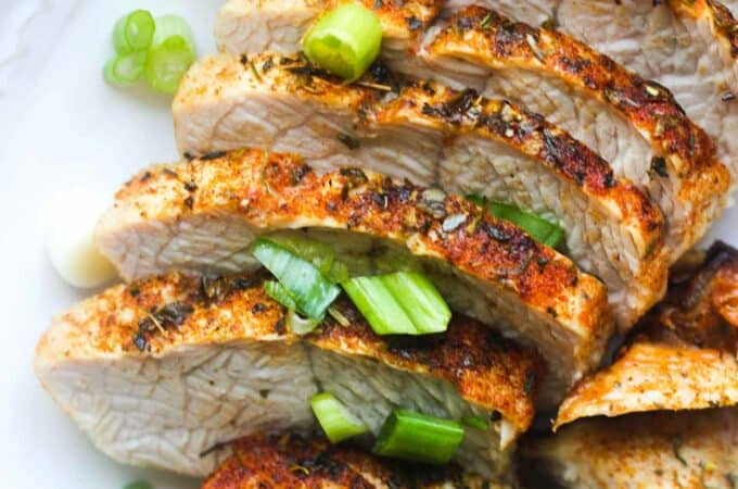 cooked turkey tenderloin with chopped green onion on top