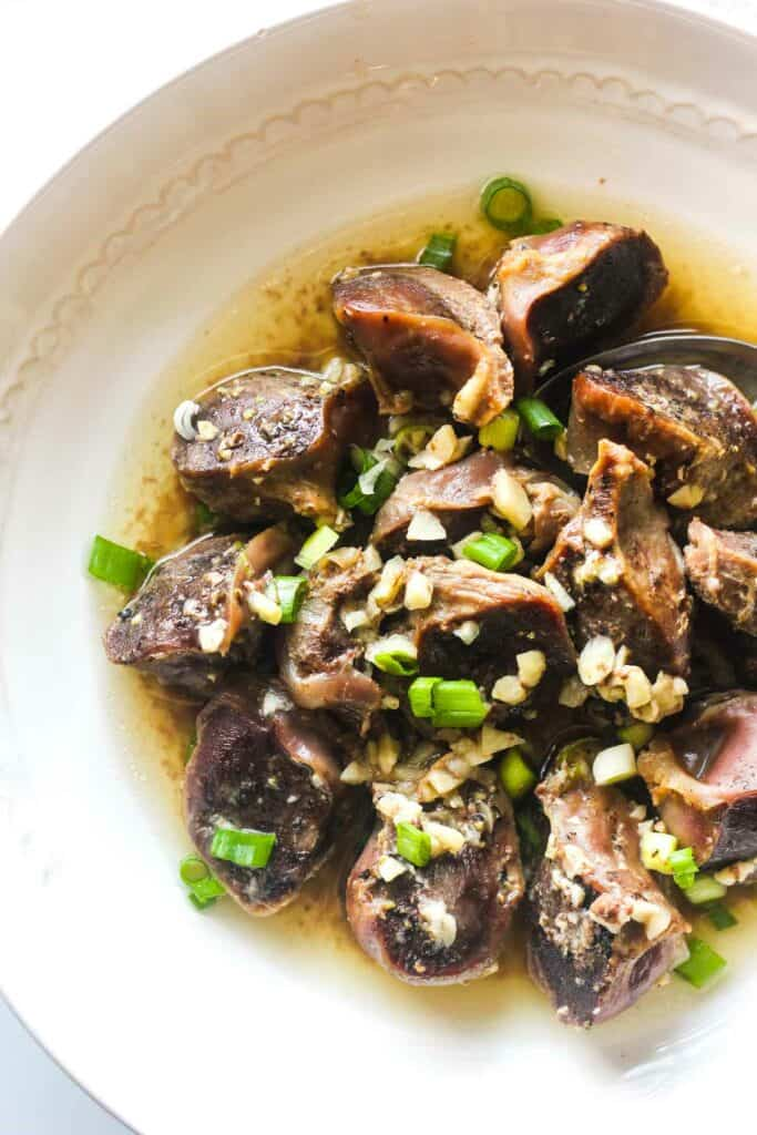 oven baked turkey gizzards with garlic and green onions